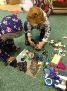 Investigating using pebbles and mirrors.